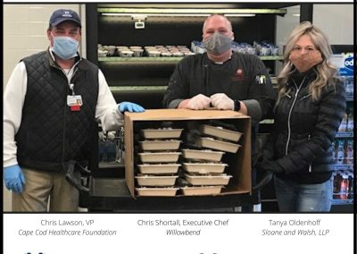 Tanya Oldenhoff and Ed Hinchey of Sloane and Walsh, LLP, help provide dinner for healthcare workers at two hospitals